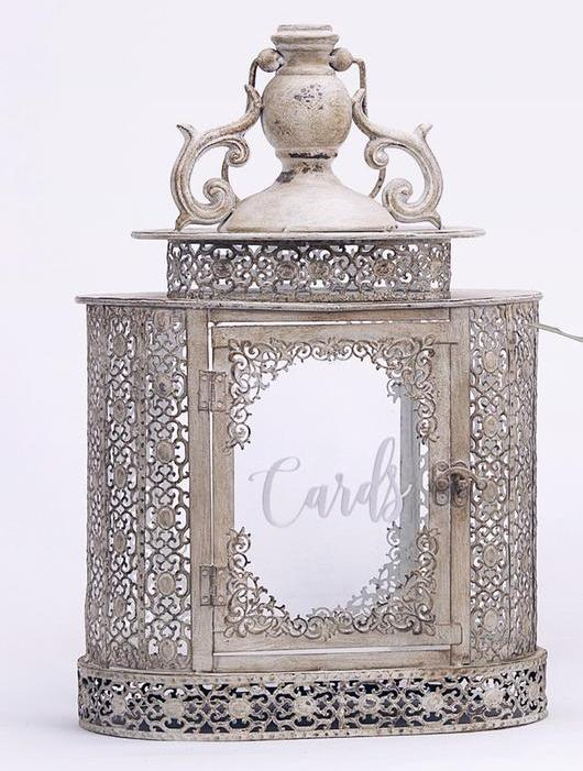 Beautiful iron wishing well with a distressed finish